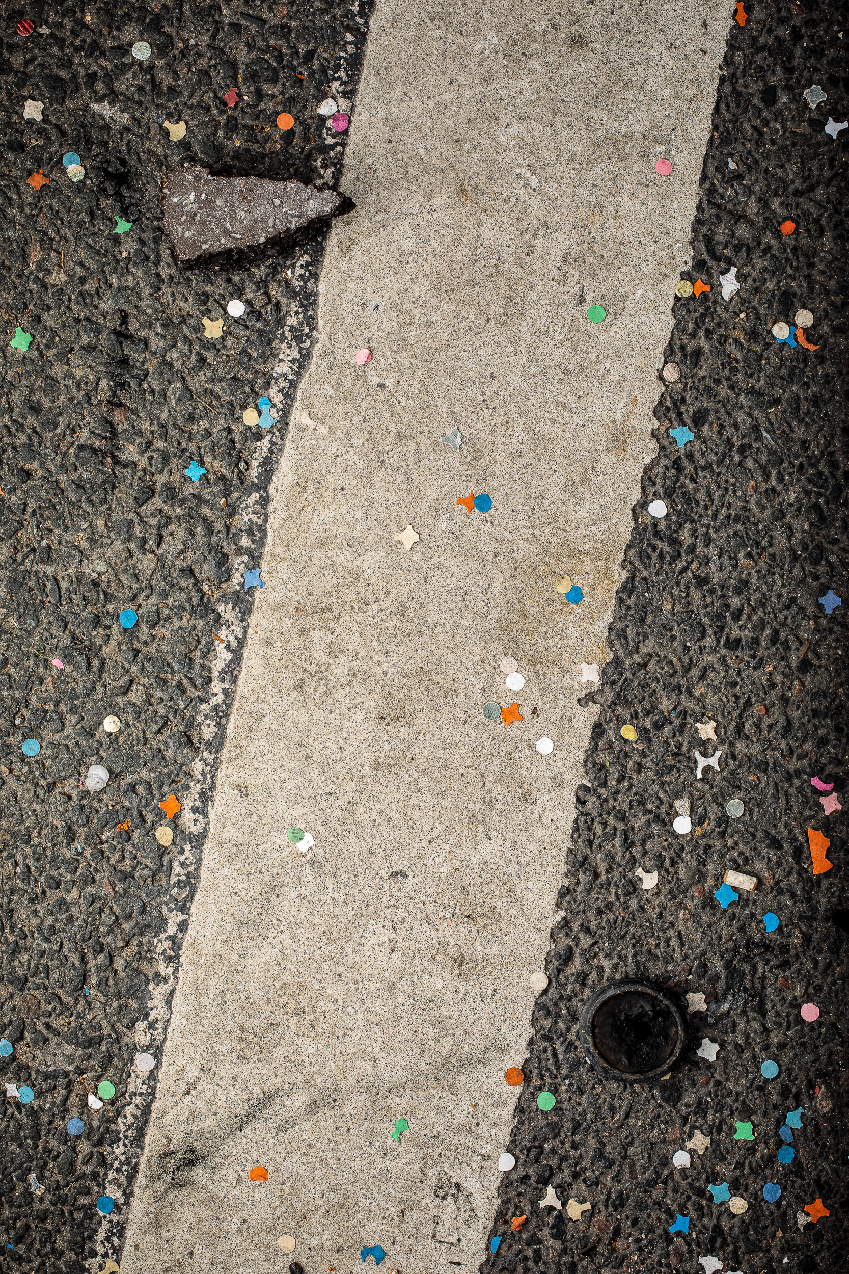 Tear gas canister, cement block and confetti, 2018