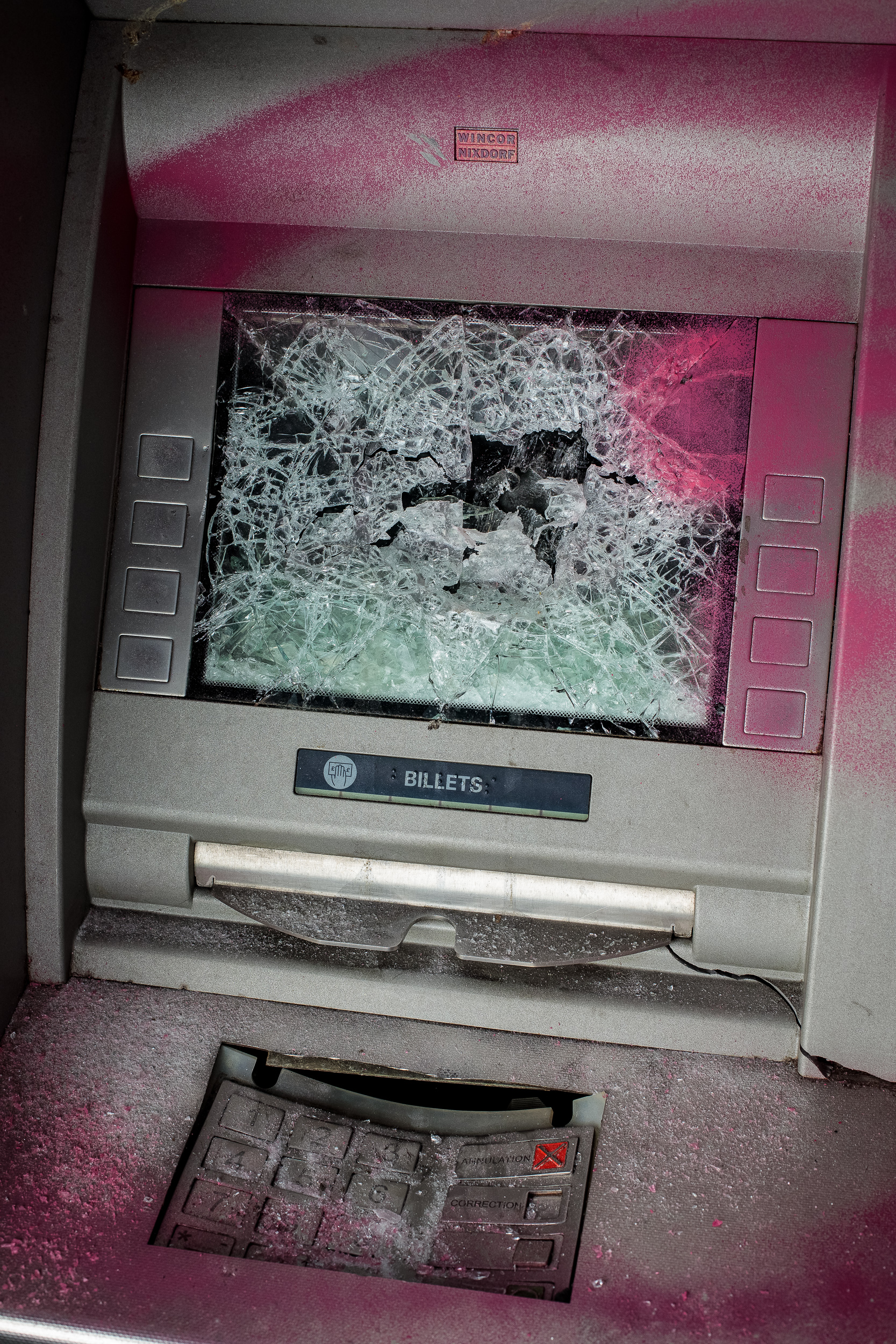 Cash machine, broken glass and spray paint, 2018