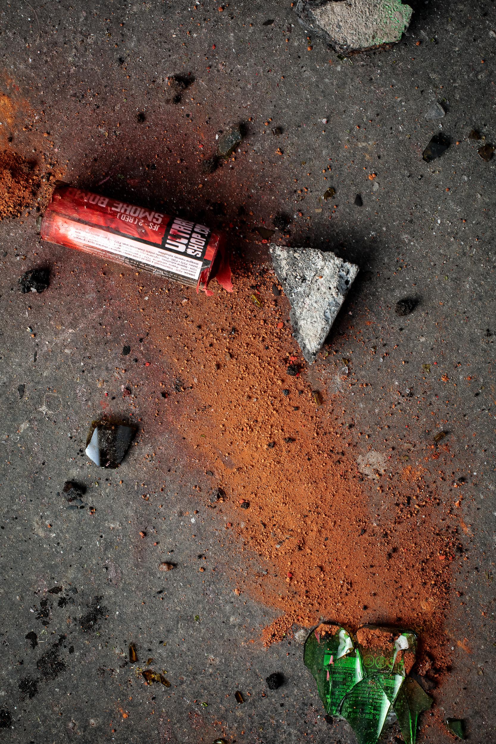 Cement blocks, red smoke bomb and broken bottles, 2018