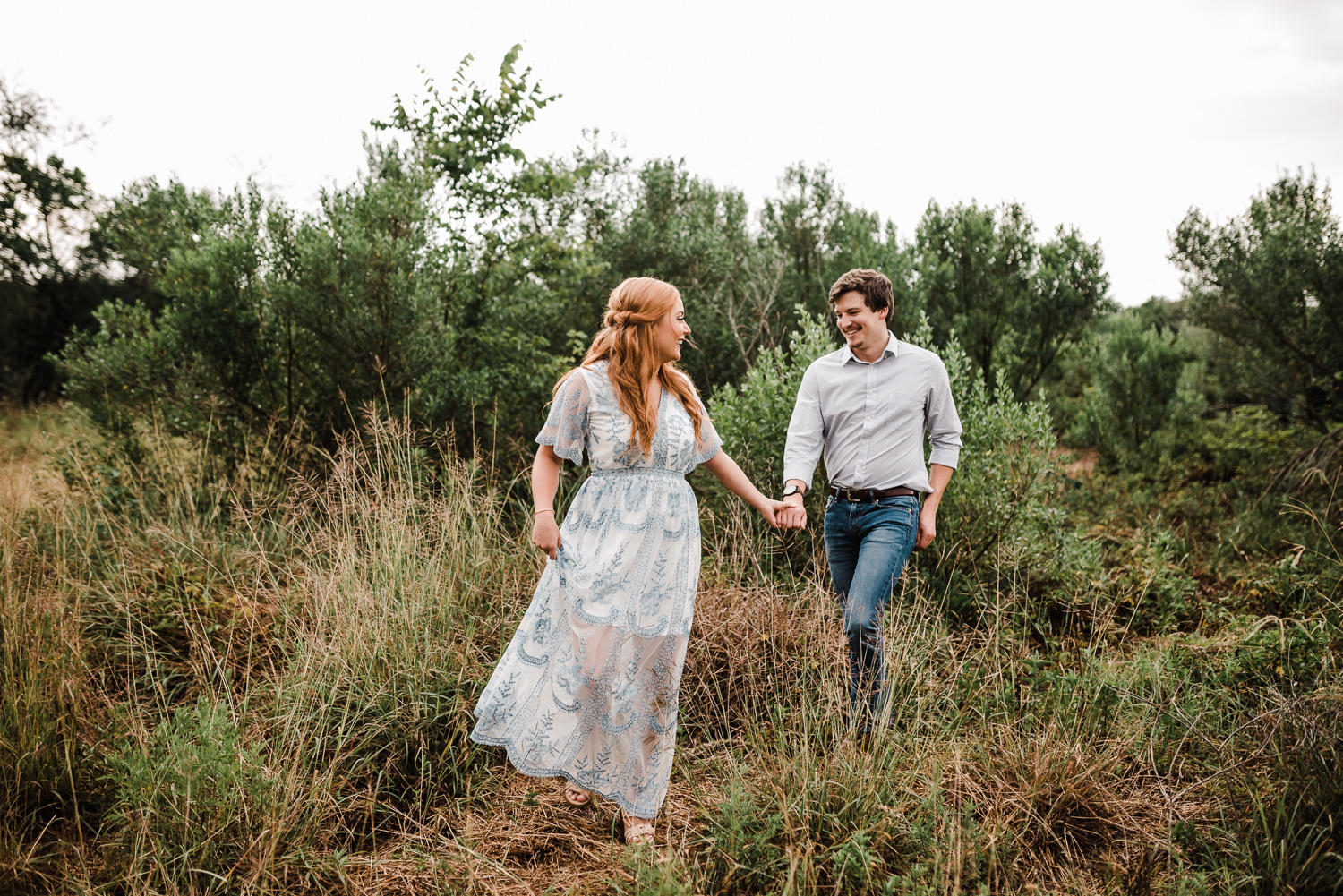 Engaged couple walking together, Engagment session in Katy Texas, Houston Texas engagement photographer, Richmond Texas engagement phtotographyer, Sweet Nest Photography
