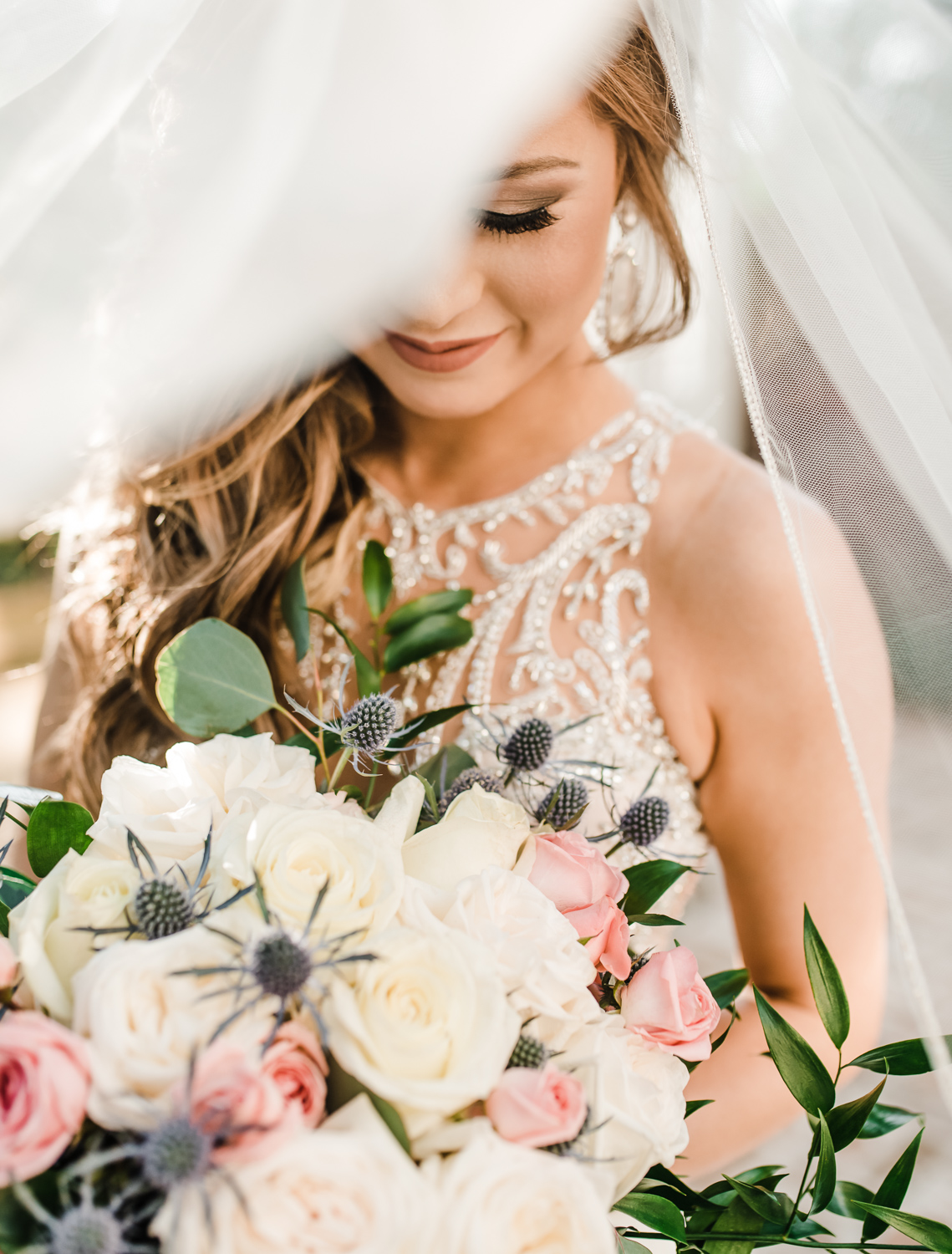 River oaks Garden club Bridal session, Bride looking at her bouquet, Houston Texas wedding photographer, Richmond, Texas, Sweet Nest Photography