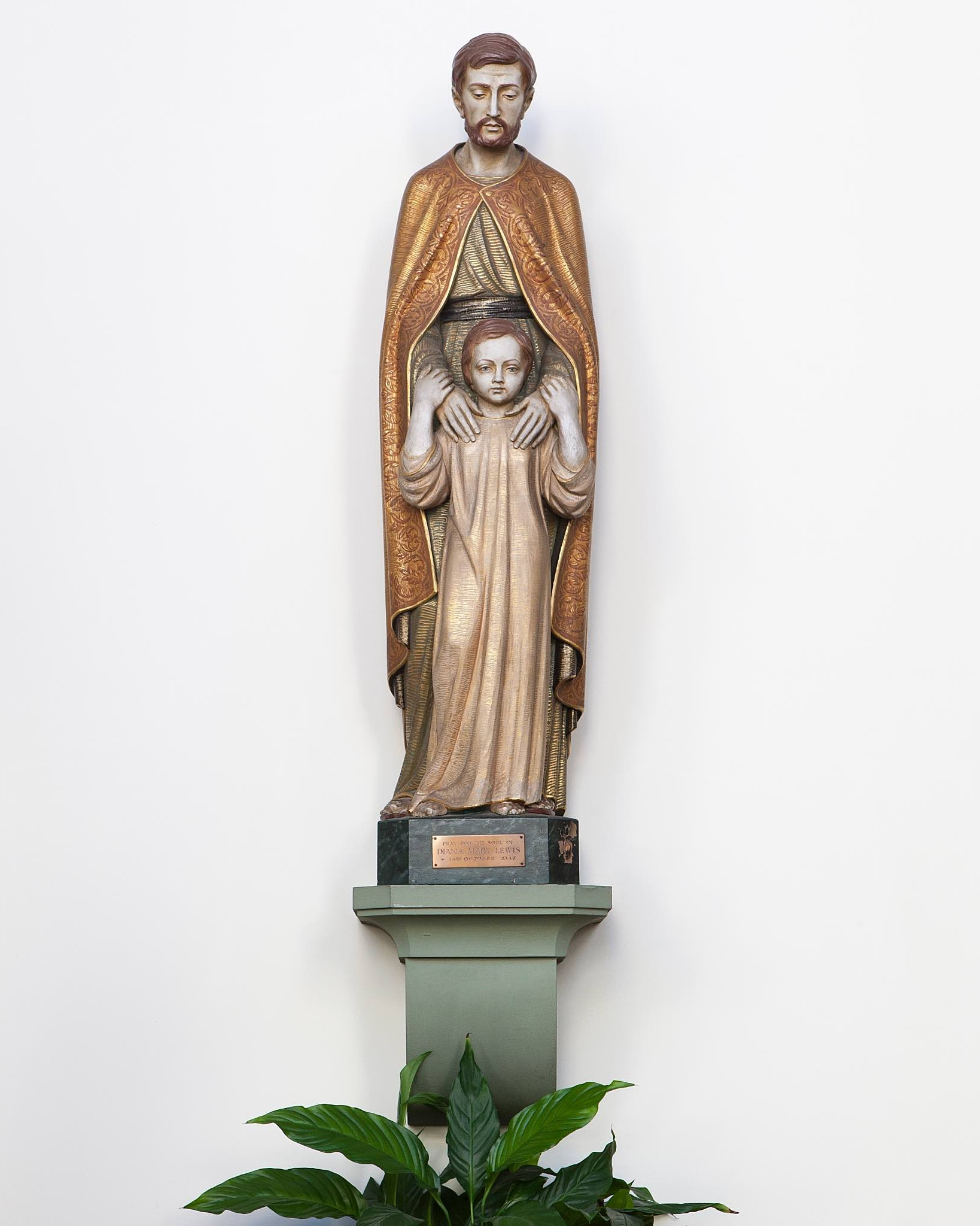 St. Joseph and the Boy Jesus - This, the third of the statues given in memory of Diana Mary Lewis, portrays Our Lord as a young boy, in the protective care of his foster father.  The Solemnity of St. Joseph is celebrated on March 19th and the memorial of St. Joseph the Worker on May 1st.
