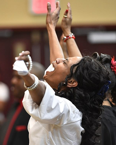 Shirl Baker reacts as her son DiAngelo Groves sings during the funeral of her daughter DeEbony Groves (Associated Press)