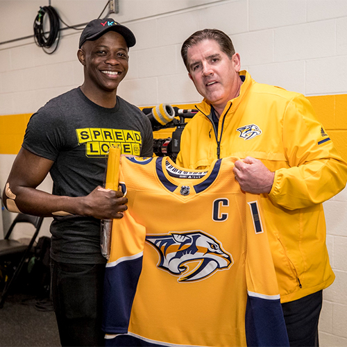 Head Coach Peter Laviolette met Waffle House hero James Shaw Jr. before the game. (Credit: Nashville Predators)