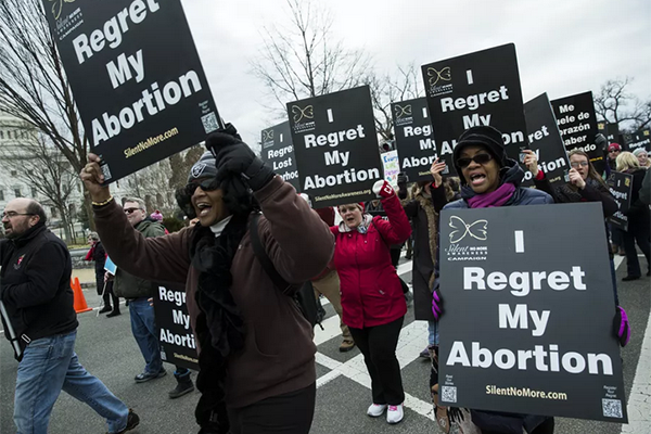 Women who have had abortions walk with thousands of pro-life demonstrators as they participate in an annual March for Life. (Samuel Corum/Anadolu Agency/Getty Images)