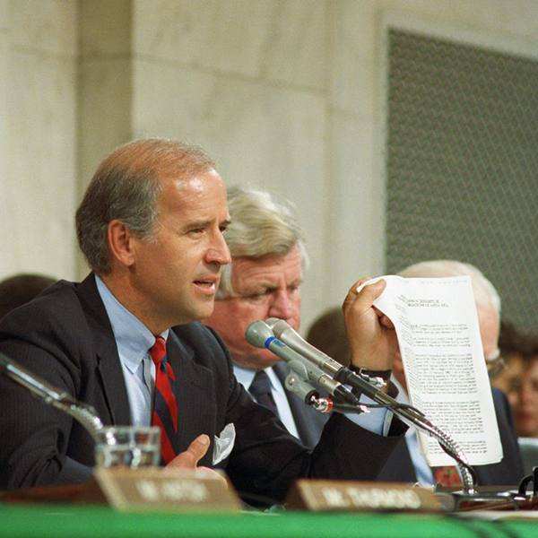 Senate Judiciary Committee Chair Joe Biden holds up a  copy of the FBI report on Anita Hill during committee hearings as Biden  questions Hill about her allegations against Judge Clarence Thomas in  1991. (Bettmann Archive)