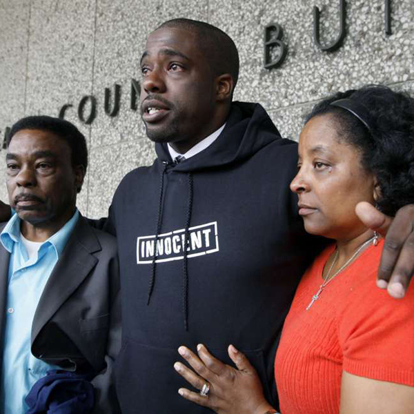 Brian Banks, center, with his mother, Leomia Myers, and father, Jonathan Banks, outside court after his rape conviction was dismissed in Long Beach, Calif., in May 2012 (Photo Credit: AP)