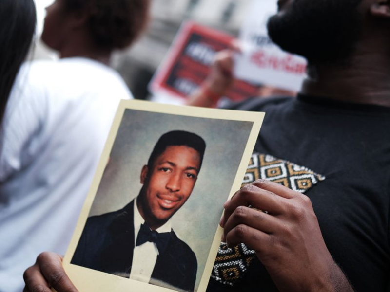 Protestors honor the memory of Eric Garner (Credit: Getty)