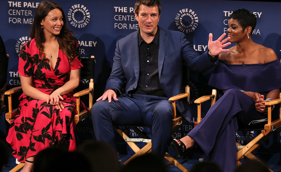 """Actress Afton Williamson, former star of """"The Rookie,"""" pictured with Melissa O'Neil and Nathan Fillion, quit her job and claimed sexual misconduct on set (Credit: Dimitrios Kambouris/Getty)"""