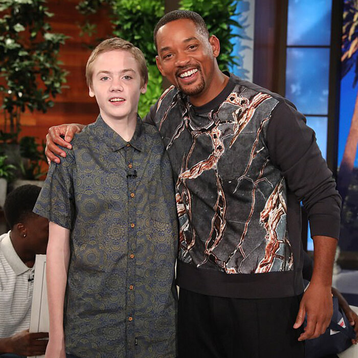 Will Smith poses with Micheal Todd, the high school boy on the receiving end of an act of kindness (Credit: Michael Rozman / Warner Bros.