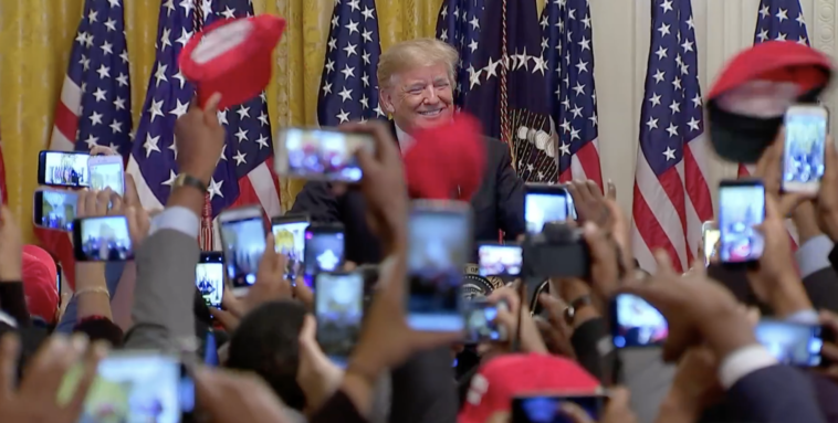 Trump with young black leaders in 2018. The support is just as enthusiastic a year later (Credit: Getty)