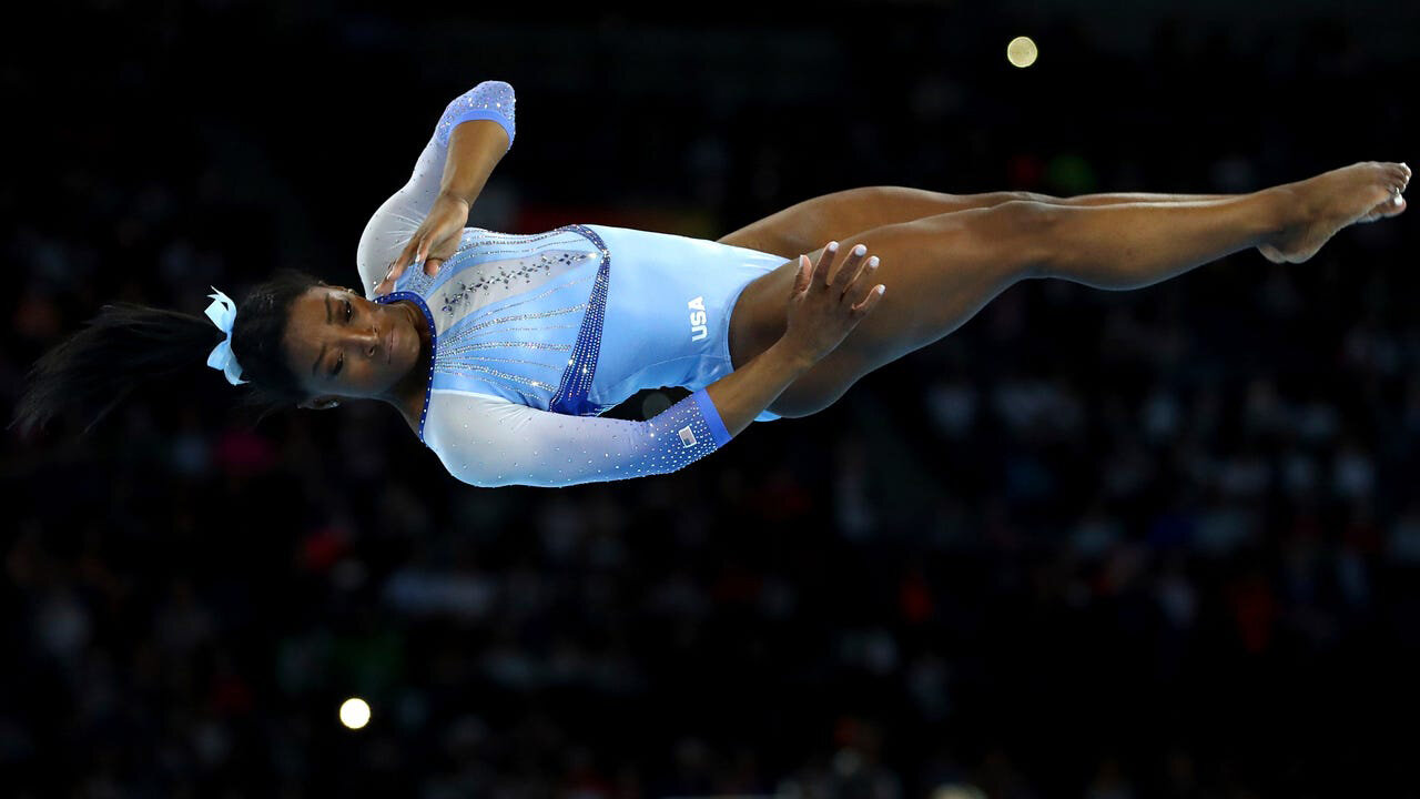 Simone Biles performs on the floor exercise during qualifying sessions for the FIG Artistic Gymnastics World Championships in Stuttgart, Germany. (Credit: Matthias Schrader, AP)