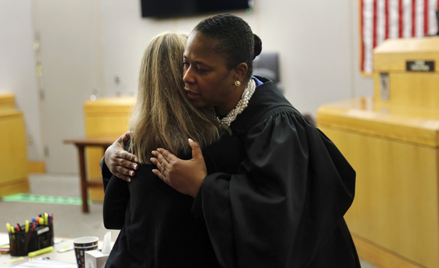 Judge Tammy Kemp gives Amber Guyger a hug after the trial is over. (Tom Fox/The Dallas Morning News via AP, Pool)