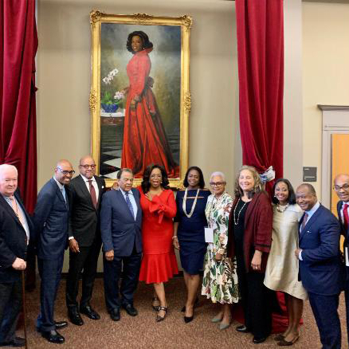 Oprah Winfrey stands in front of a portrait unveiled in her honor at Morehouse College in Atlanta, Georgia, on Monday, October 7, 2019. (Credit: Morehouse)