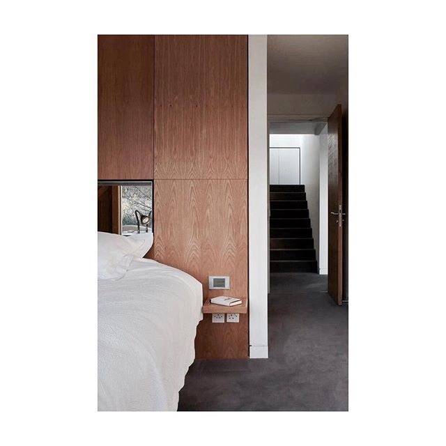 Oak clad walls make this bedroom feel warm #bedroom #oak #wood #warmth #mirror