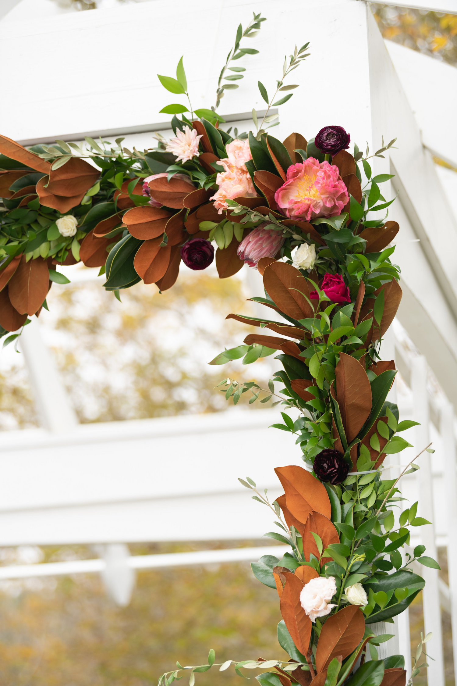 magnolia ceremony arch floral design