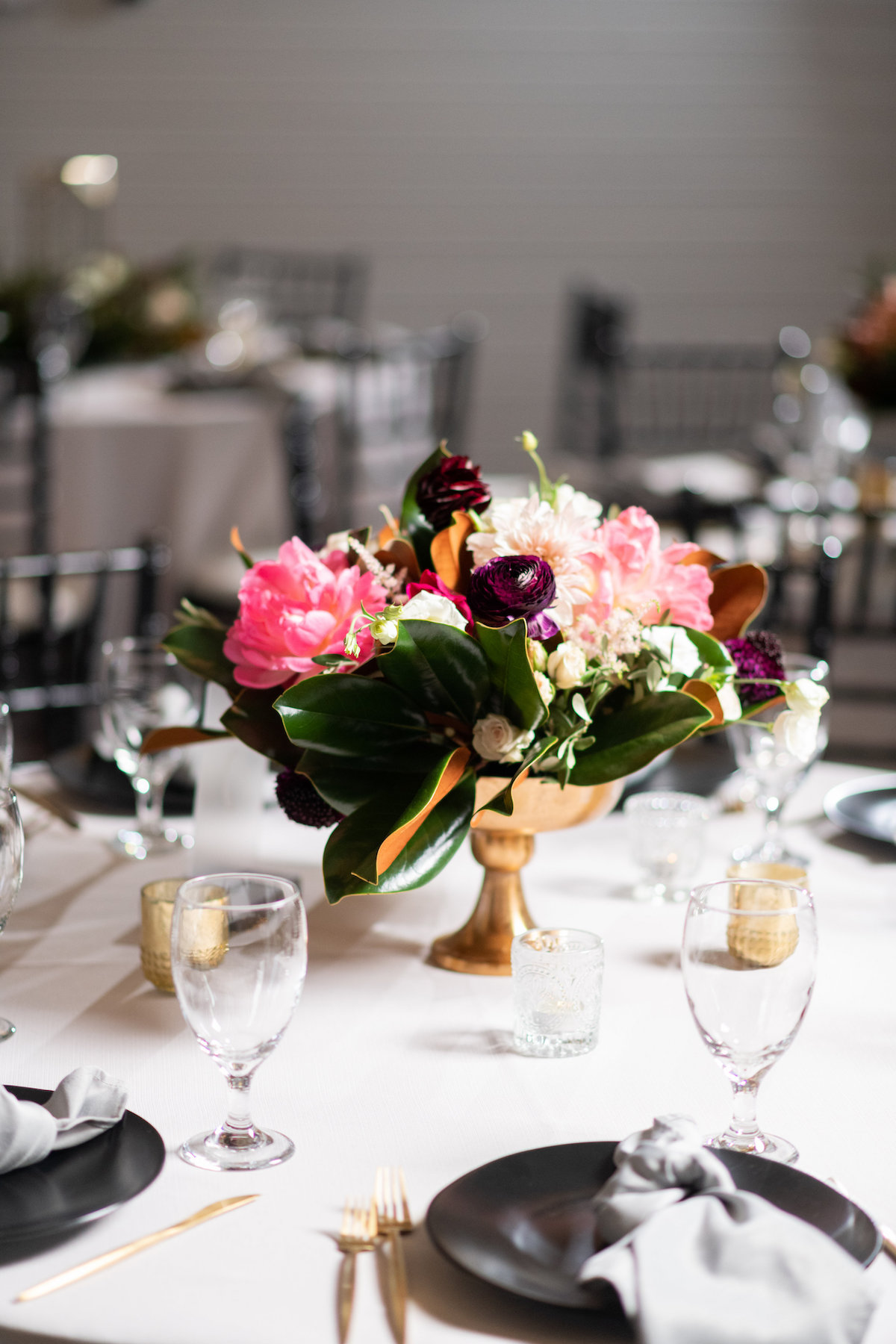 moody, colorful reception centerpiece arrangement