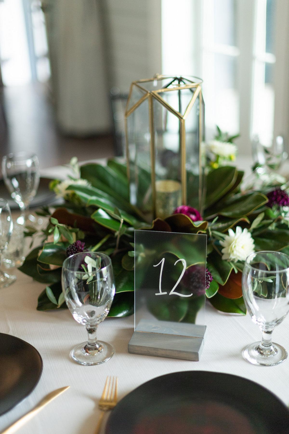 magnolia centerpiece arrangement for modern wedding reception