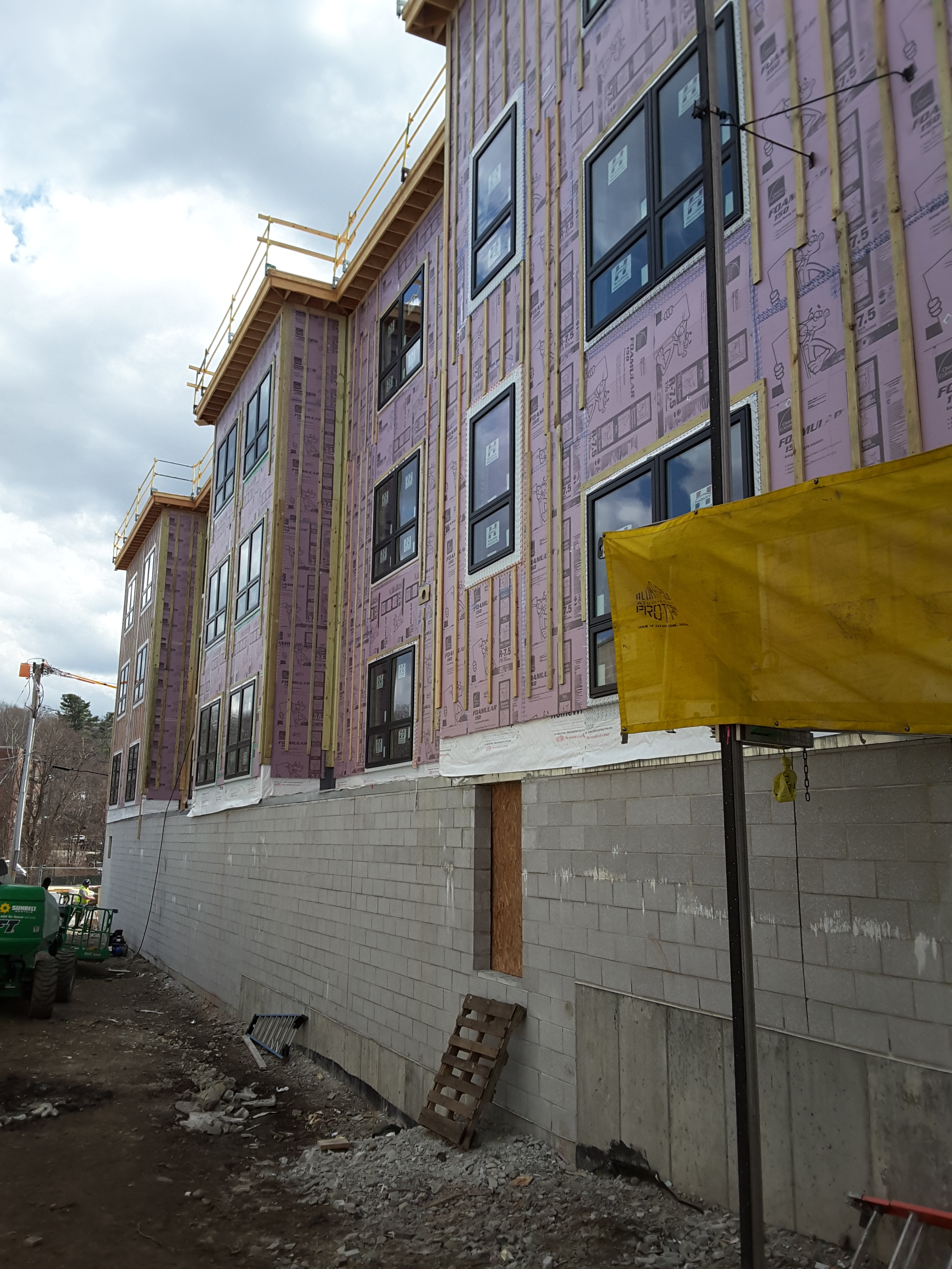 Installation of insulation and siding