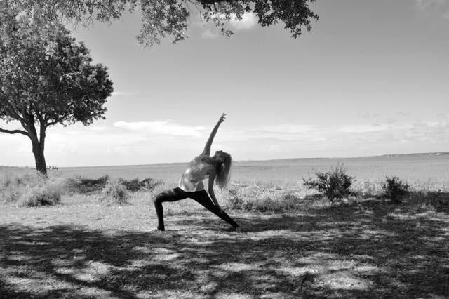 Kaitlyn R. Swicegood practicing yoga.
