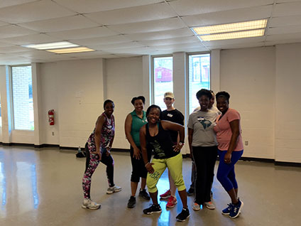 Chisa Putman of City of Rock Hill Solicitor's Office, Emily Brown of York County Government, Mariama Glascoe-Kirkland of Glascoe-Kirkland Legal Services, LLC   , and  Jessica King of Williams Mullen , enjoying a Zumba instruction.