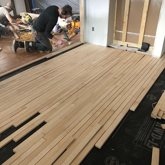 "Flooring day! 2 1/4"" maple in the kitchen will look seamless with adjacent dining room. Will get a nutmeg stain tomorrow with a sealer coat. Silver grout in our encaustic bath floor."