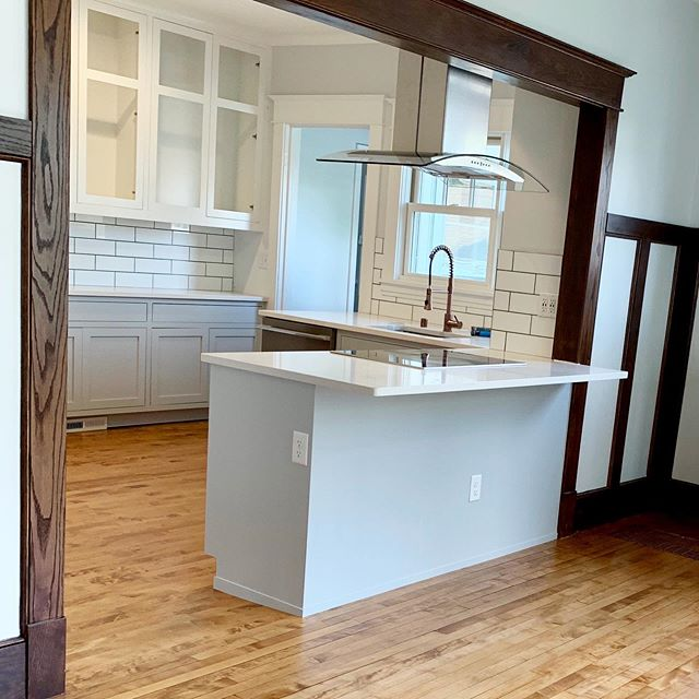 Getting close on this kitchen in Hopkins. We opened the floorplan, matched the wood details on the floor and walls, and updated everything. Love the decisions these homeowners made to keep the new kitchen looking like a seamless part of the old home. #newkitchen #maplefloors #customremodel #insetcabinets #subwaytile