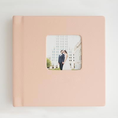 Cameo Window - Add a photo to the cover of their album. With square windows to compliment your album size and inlaid photos for a hand-crafted feel.