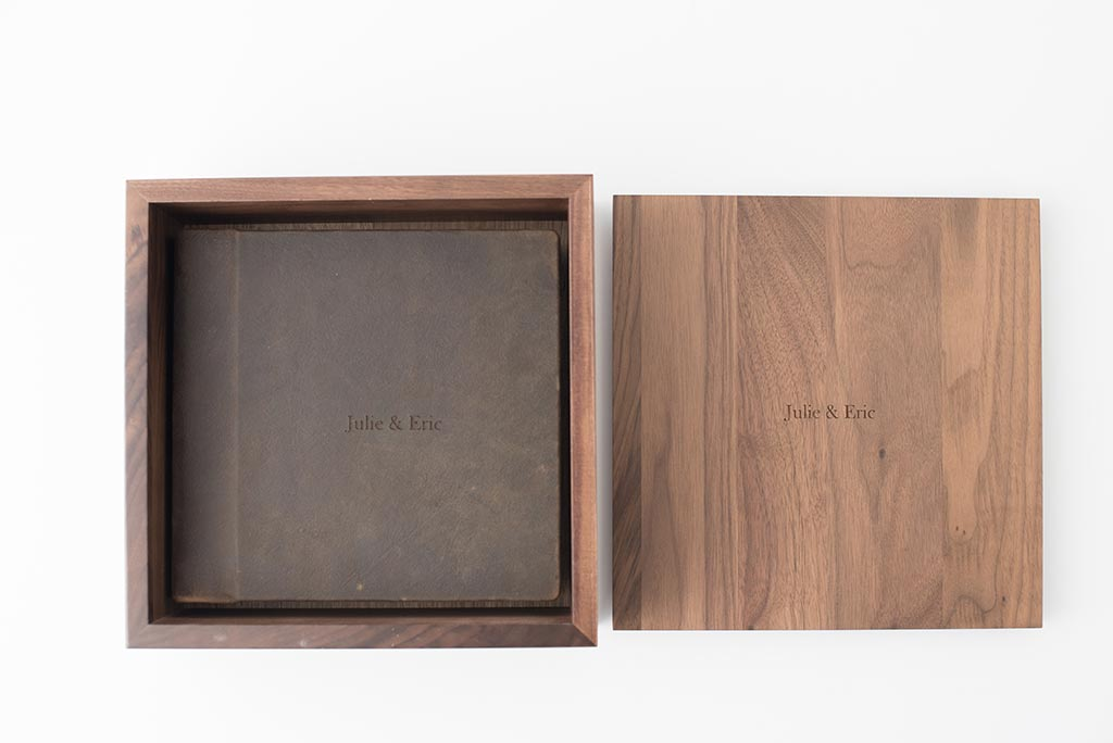 WALNUT BOX - Incredibly smooth finish on this beautiful, dark hardwood. As you pick up the box you will remark at the weight of the dense Walnut walls - a true testament to its durability. Pairs perfectly with thick-paged albums. Price $357