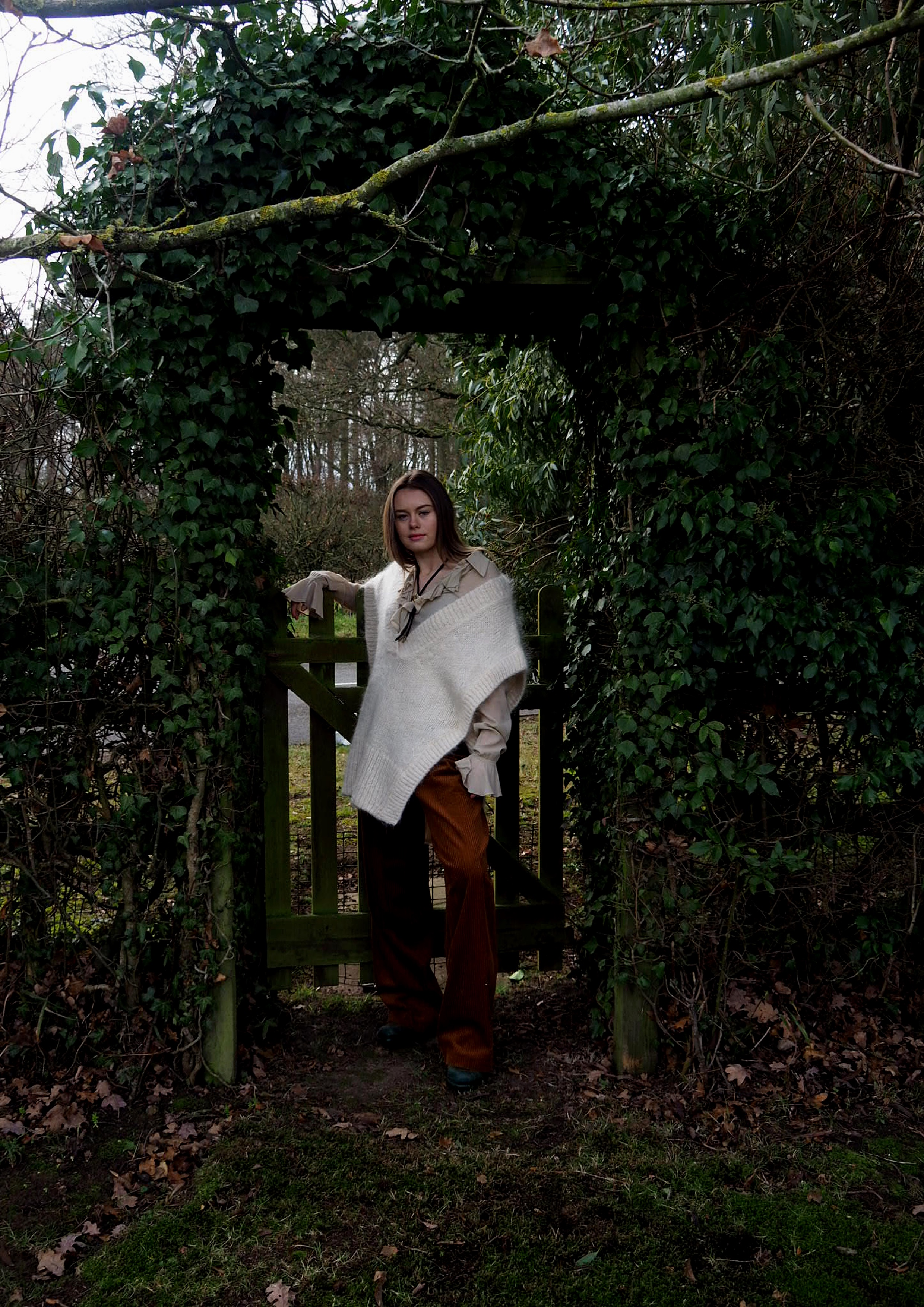 Emily wears vintage blouse, jumper by & Other Stories, trousers by H&M, boots by Hunter