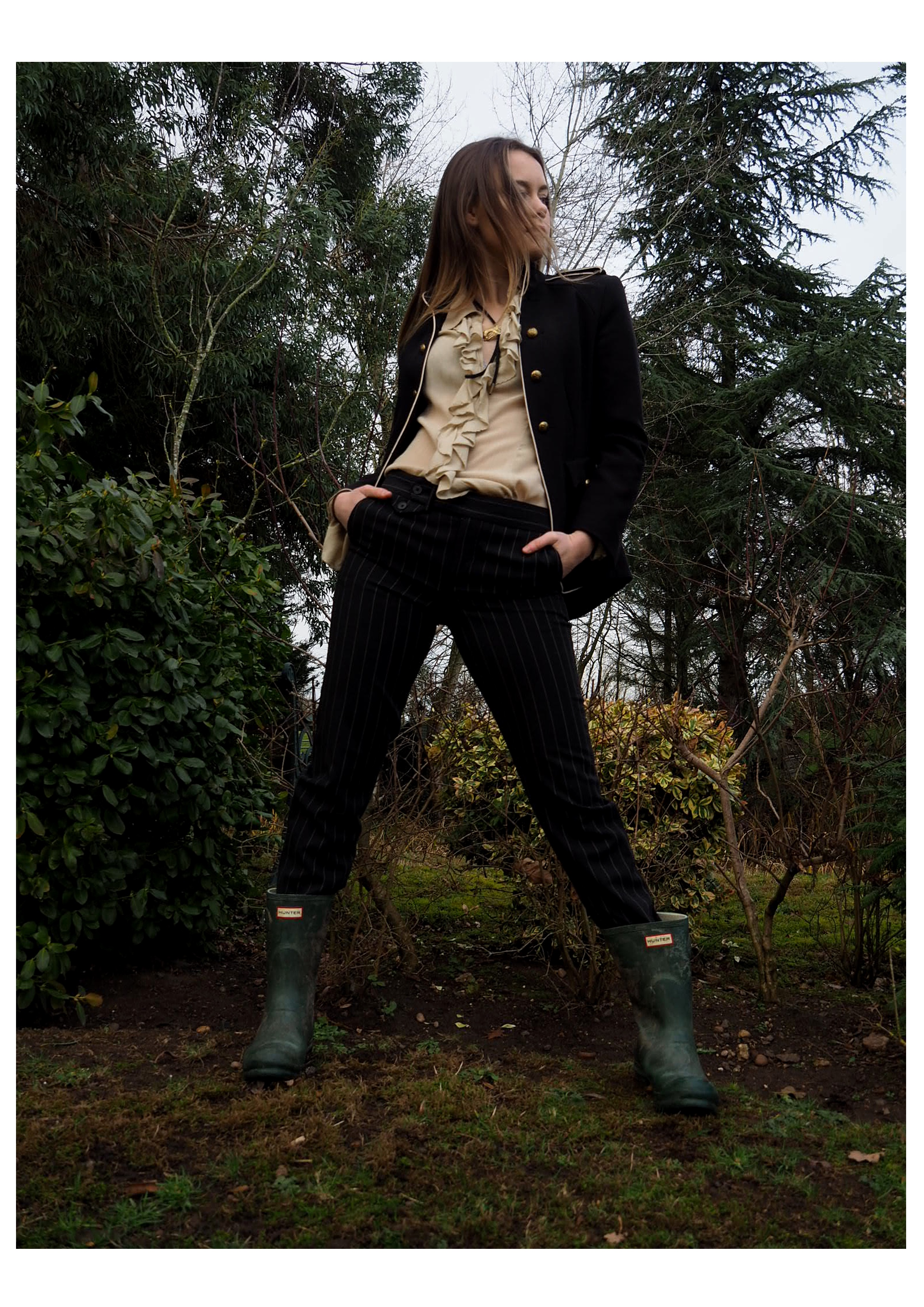 Emily wears vintage blouse, vintage necklace, vintage, trousers, jacket by Zara, boots by Hunter