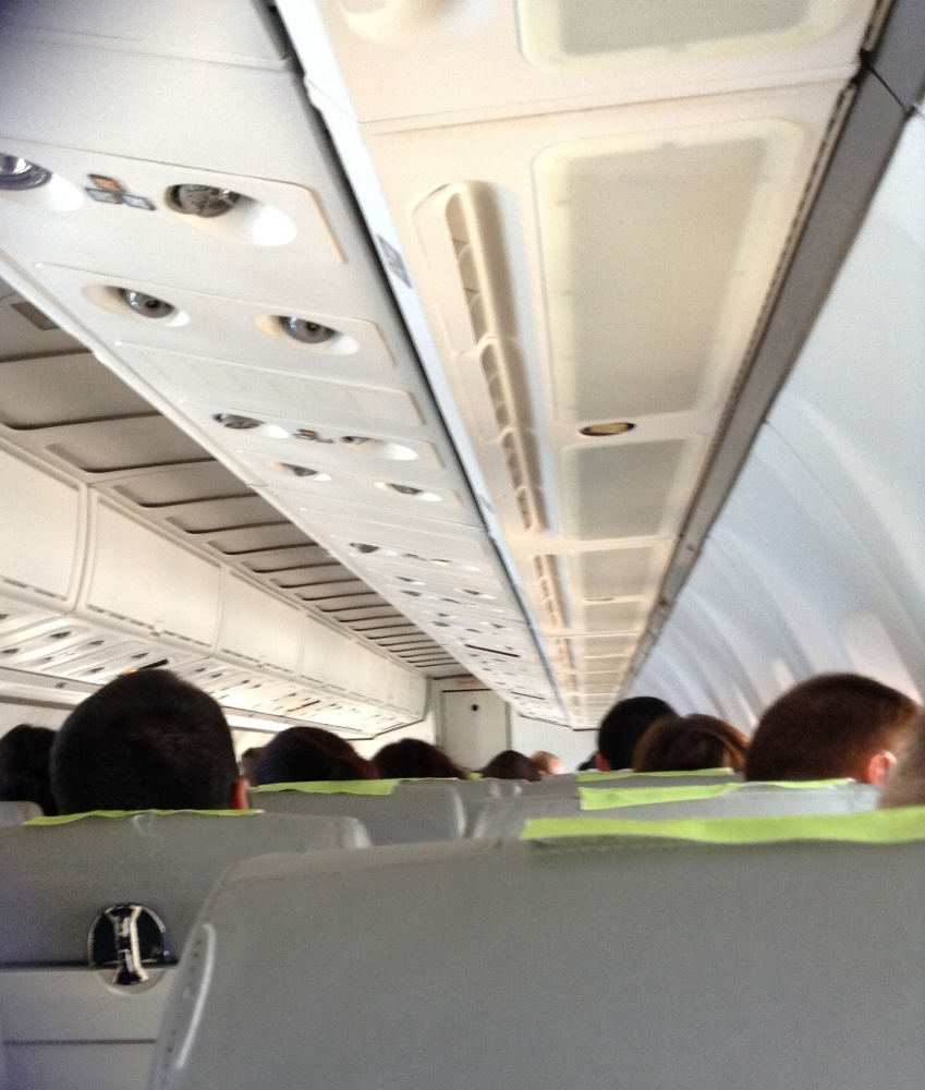 In an airplane...going somewhere.