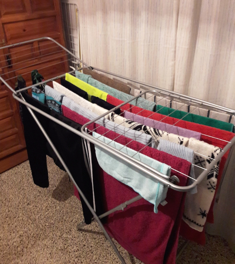 The  tendedero  is like a portable clothing line that can be used indoors or outdoors.