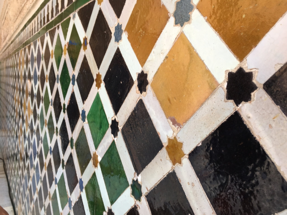 These classic Spanish-style tiles actually have a lot of Arab influence in them, however, the Arab community is not very integrated into Spanish life. These are the types of things that I question.