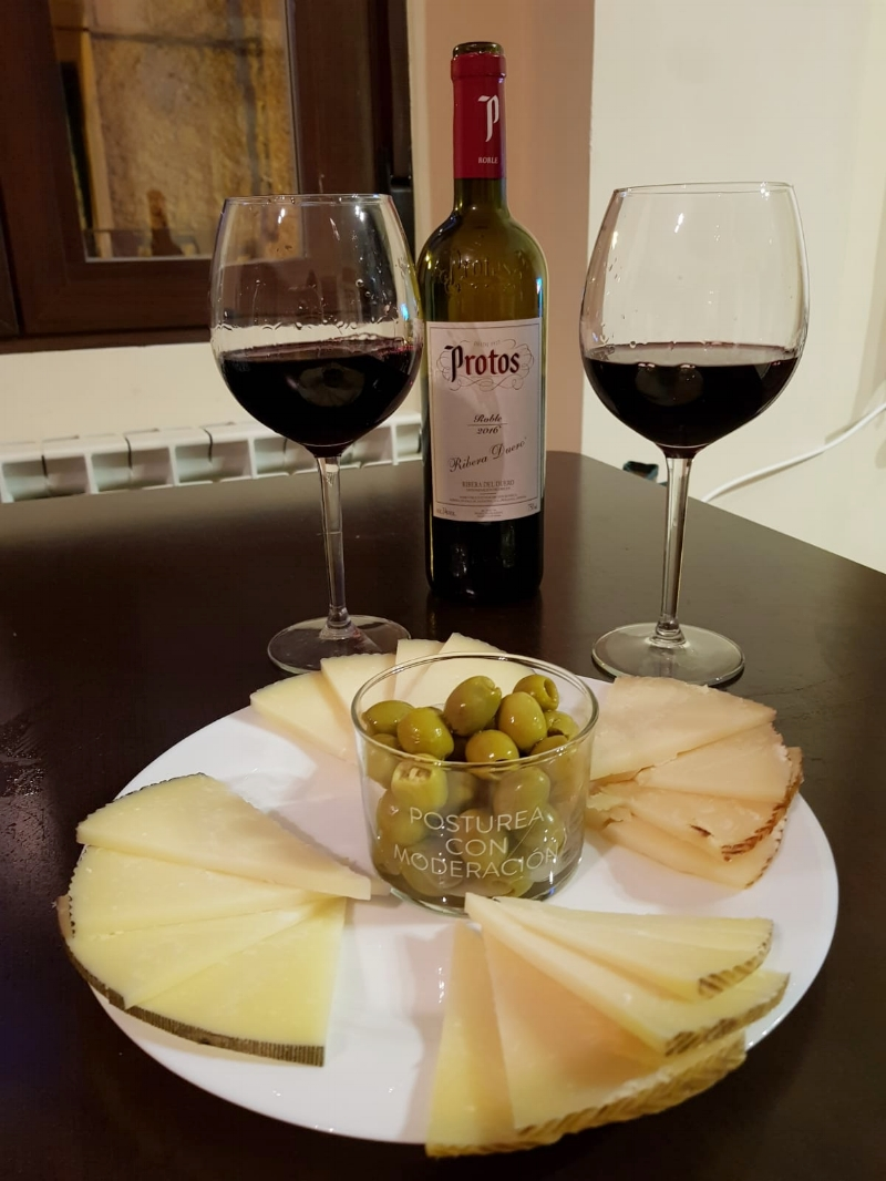 A lovely wine-and-cheese night taste-testing (from far back, clockwise) the  curado, oveja tostado, oveja viejo,  and  oveja curado.