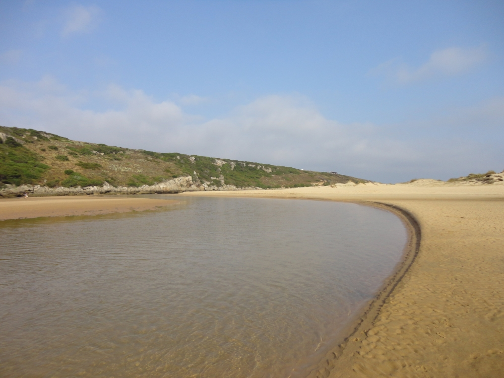 Praia da Amoreira is fed by the river, making it a great place to float along with the tide.