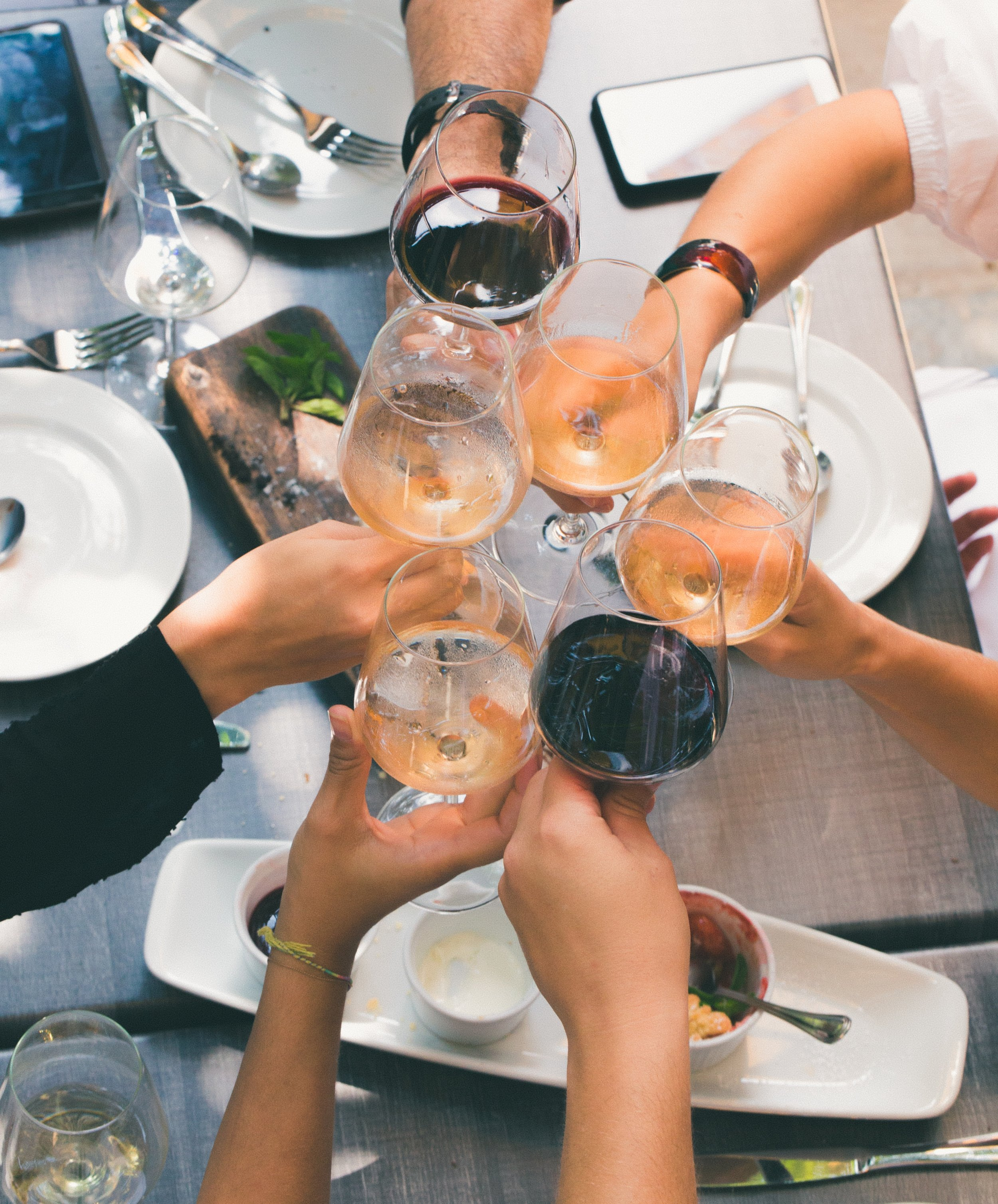 People celebrating with wine. Photo by andres chaparro on Pexels