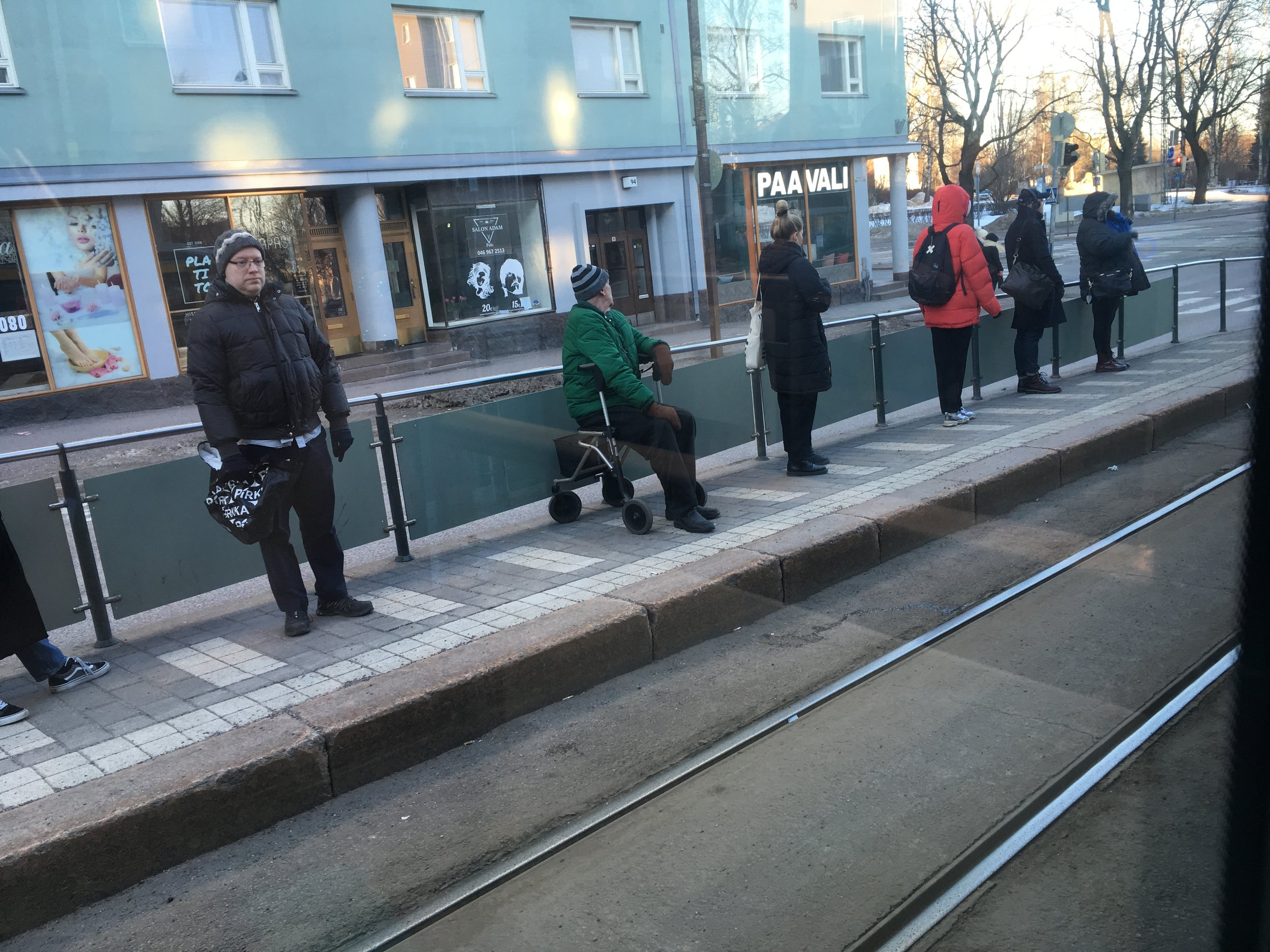 Watching people waiting for the tram in Helsinki is nothing like people waiting for the bus in Granada.