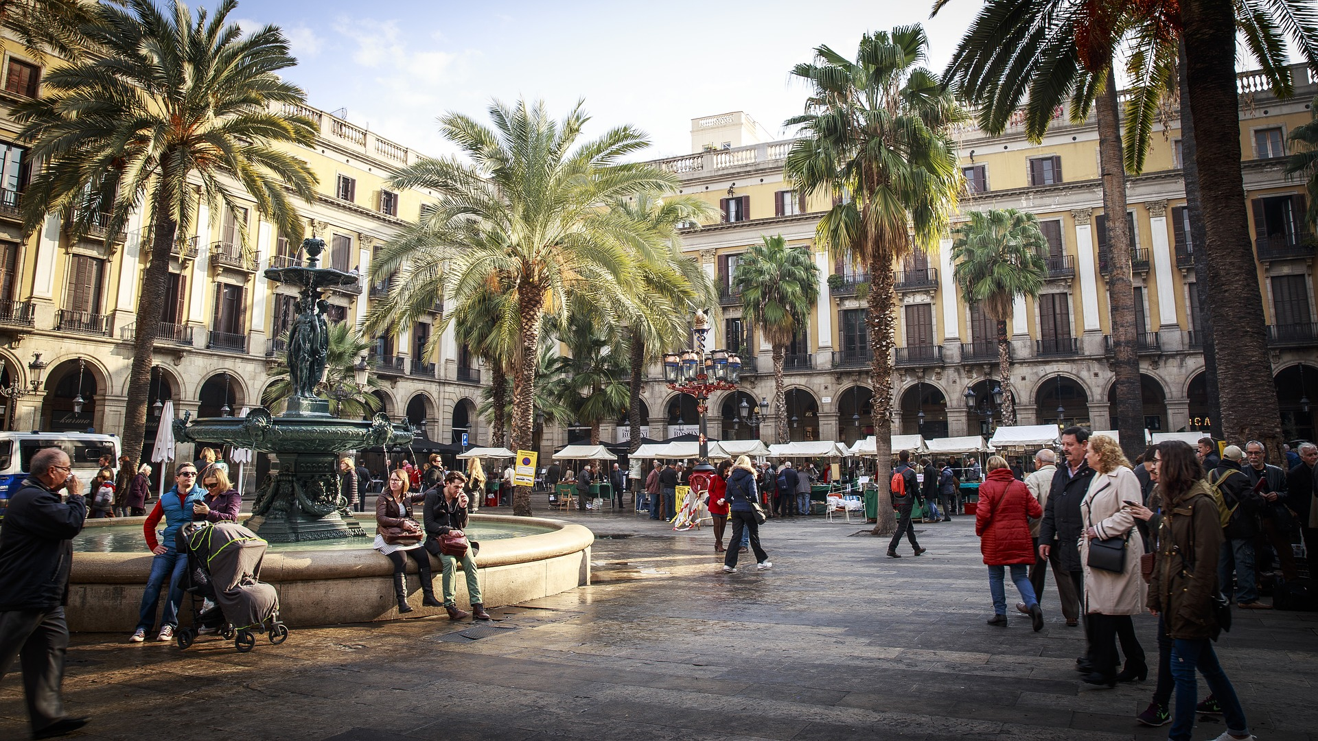 People in a square in Barcelona. Photo by skaramelka on Pixabay
