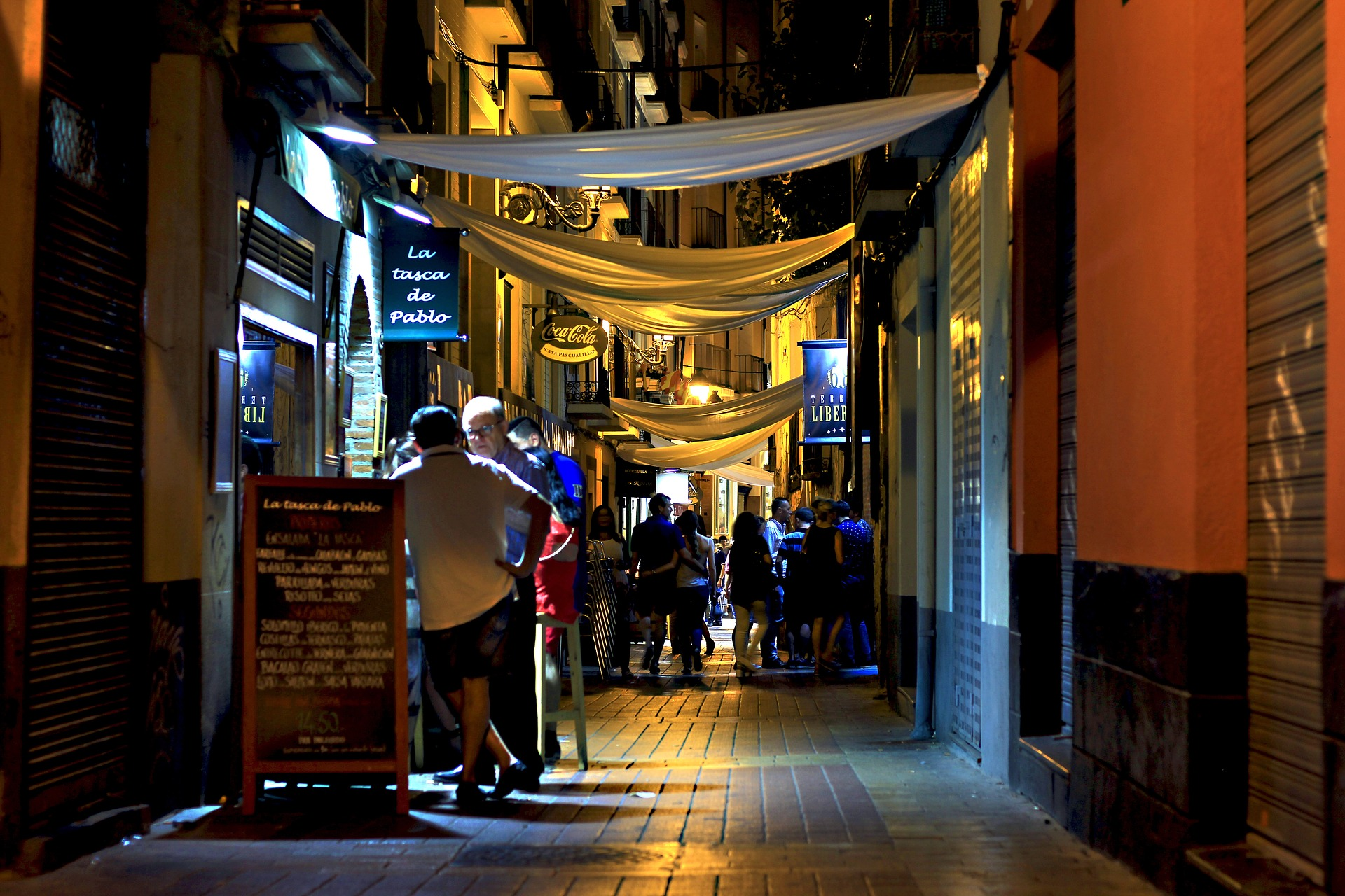People in a bar at night in Spain. Photo by Daniel_Nebreda on Pixabay