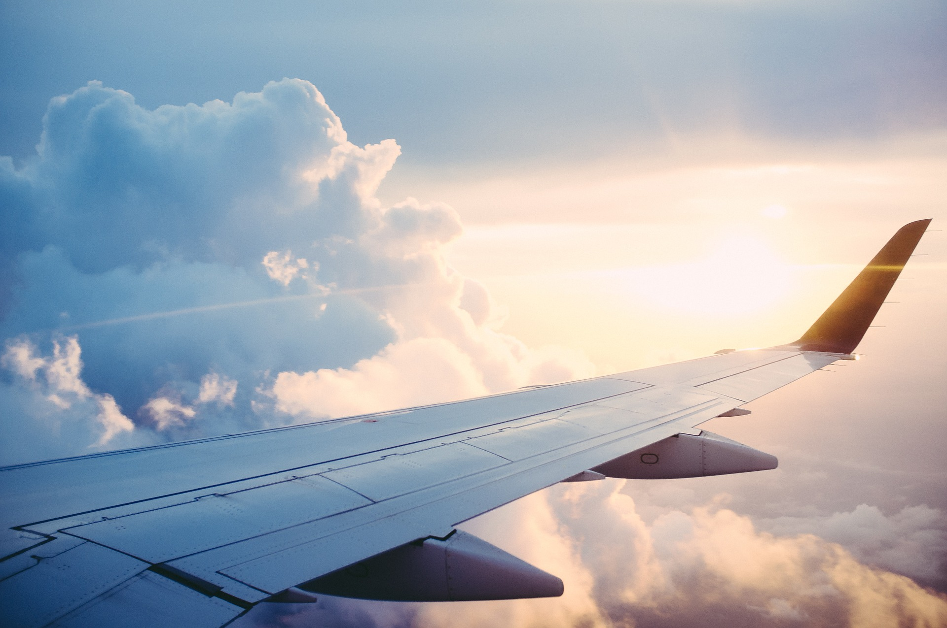 View from an airplane window. Photo by Free-Photos on Pixabay.