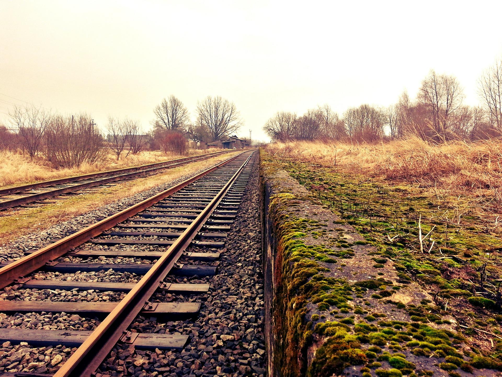 Train tracks. Photo by CodeCondo on Pixabay.