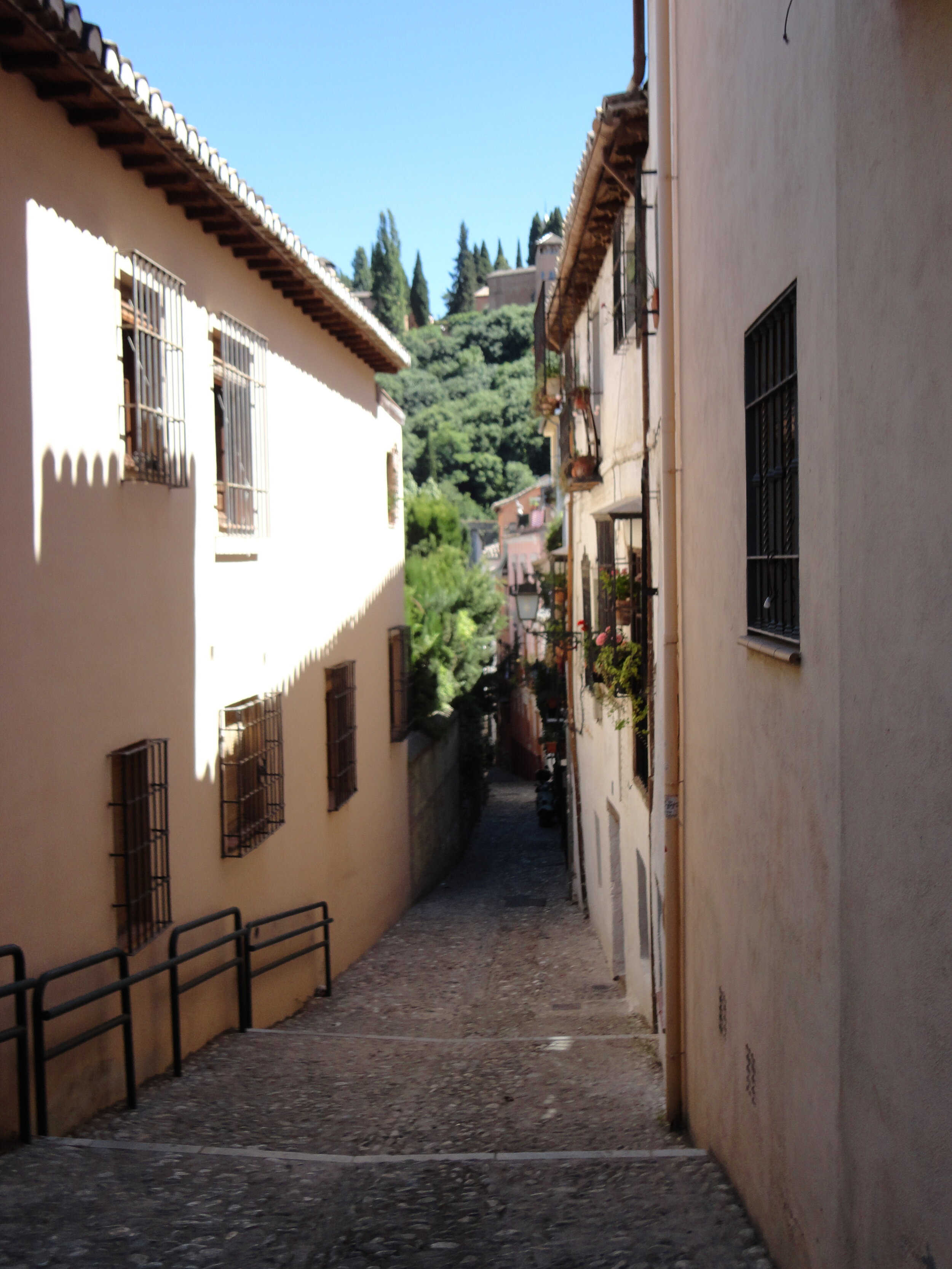 Windy streets with a view of the Alhambra. Granada, Spain