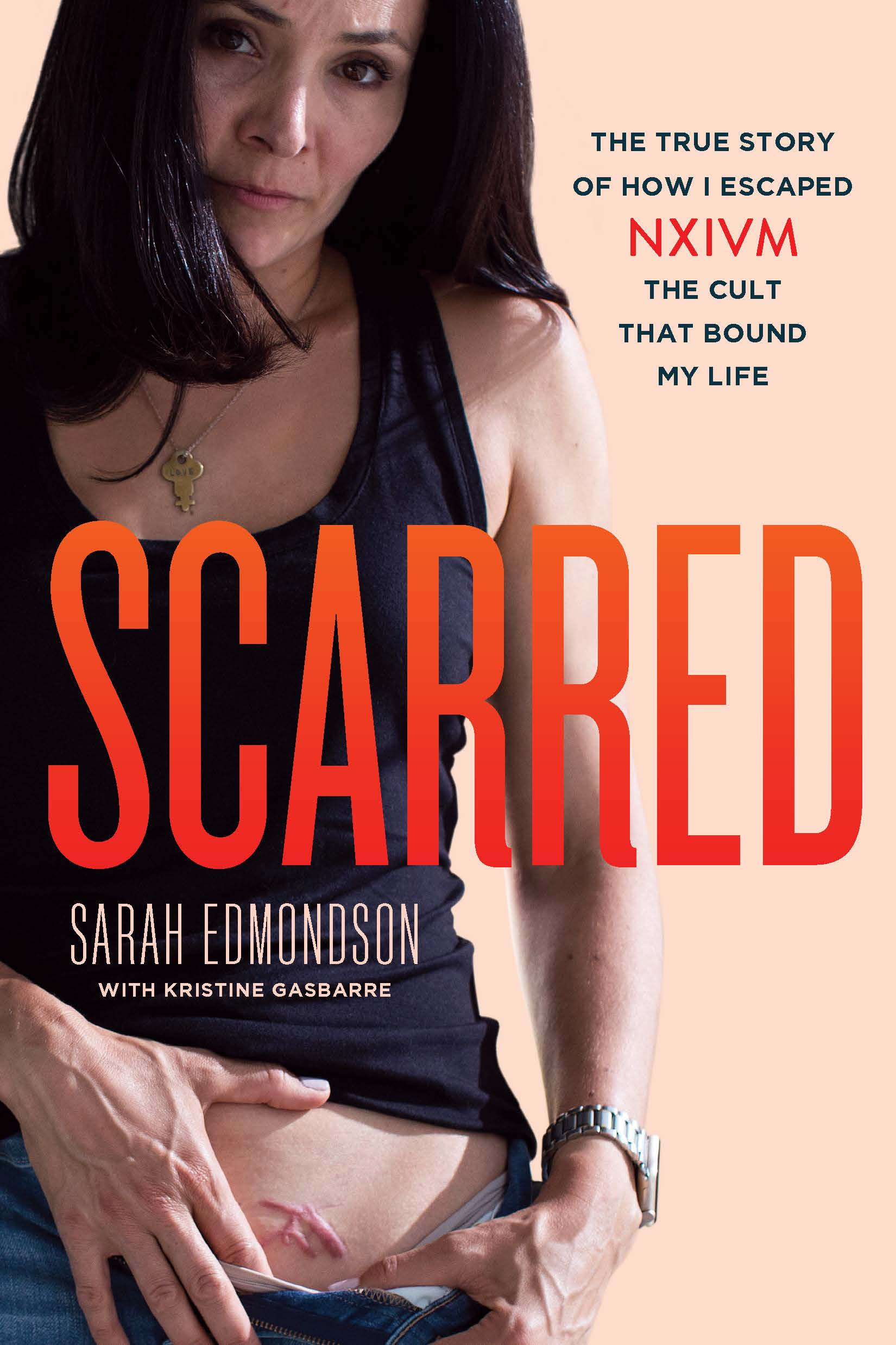 """""""Master, would you brand me? It would be an honor."""" - Read the shocking and subversive memoir of a 12-year-NXIVM-member-turned-whistleblower, and her inspiring true story of abuse, escape, and redemption. A portion of the profits will be devoted to starting a foundation for victims of NXIVM—to support their healing and recovery.AMAZON (All Countries)BARNES & NOBLEINDIEBOUNDAPPLE BOOKSINDIGO (Canada)WATERSTONES (UK)BOOKTOPIA (Australia)MIGHTY APE (New Zealand)In 2005, Sarah Edmondson was a young actress getting her start in Vancouver and hungry for purpose. When NXIVM, a personal and professional development company, promised to provide the tools and insight to reach her potential and make an impact, Sarah was intrigued. She would go on to become one of the cult's most faithful (and effective) devotees. Over her twelve-year tenure, Sarah enrolled over 2,000 people and operated her own NXIVM center in Vancouver.Of course, things were not what they seemed. As Sarah progressed up NXIVM's """"Stripe Path,"""" questions kept coming up about the organization's rules and practices. Why did the organization prevent members from asking questions? Why did those who did ask questions promptly leave or disappear? These questions came to a head in 2017 when Sarah accepted an invitation from her best friend, Lauren Salzman, to join DOS, a """"secret sisterhood"""" within NXIVM and headed to the headquarters in Albany for the initiation ceremony. Thanks to Sarah's fearlessness as she put her life on the line, that ceremony would mark the beginning of the end of NXIVM.In this tell-all memoir, complete with personal photographs, Sarah shares her true story from the moment she takes her first NXIVM seminar, revealing in-depth details of her time as a member, including what happened on that fateful night in Albany, and her harrowing fight to get out, help others, and heal. This is also a true story about abuses of power, the role female friendships play in cults, and how sometimes the search to be"""