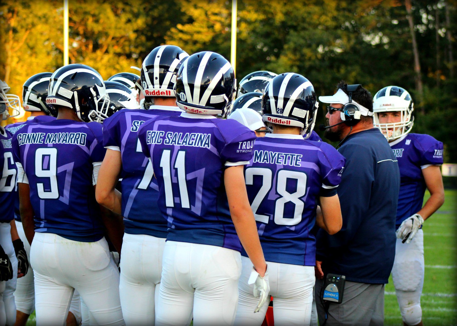 The Fruitport Trojans in the huddle during their Trojan Strong game against GR Union. The Trojans won 41-0.