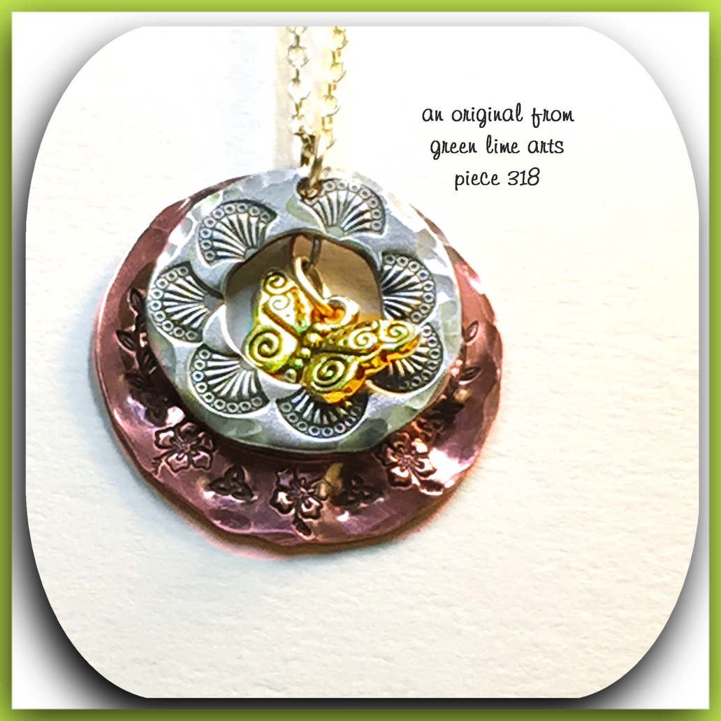 hand-stamped one of a kind      metal pendants