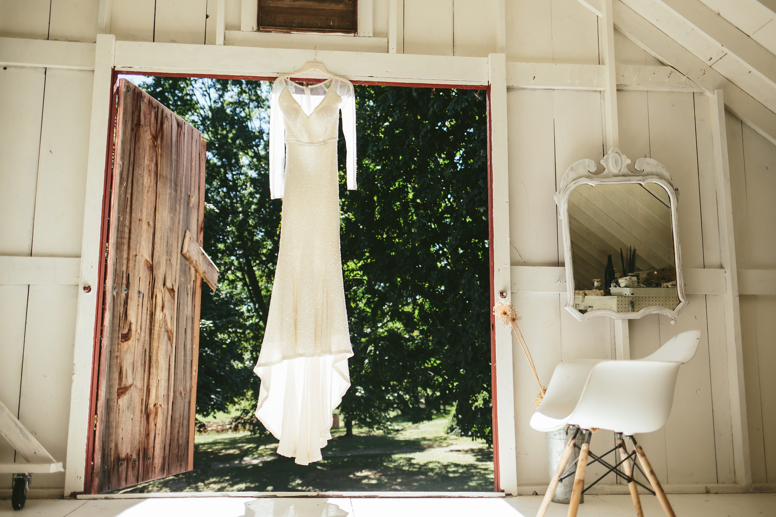 hudson-valley-farm-weddings-pioneer-farm-weddings-warwick-ny-white-wedding-dress-in-barn.jpg