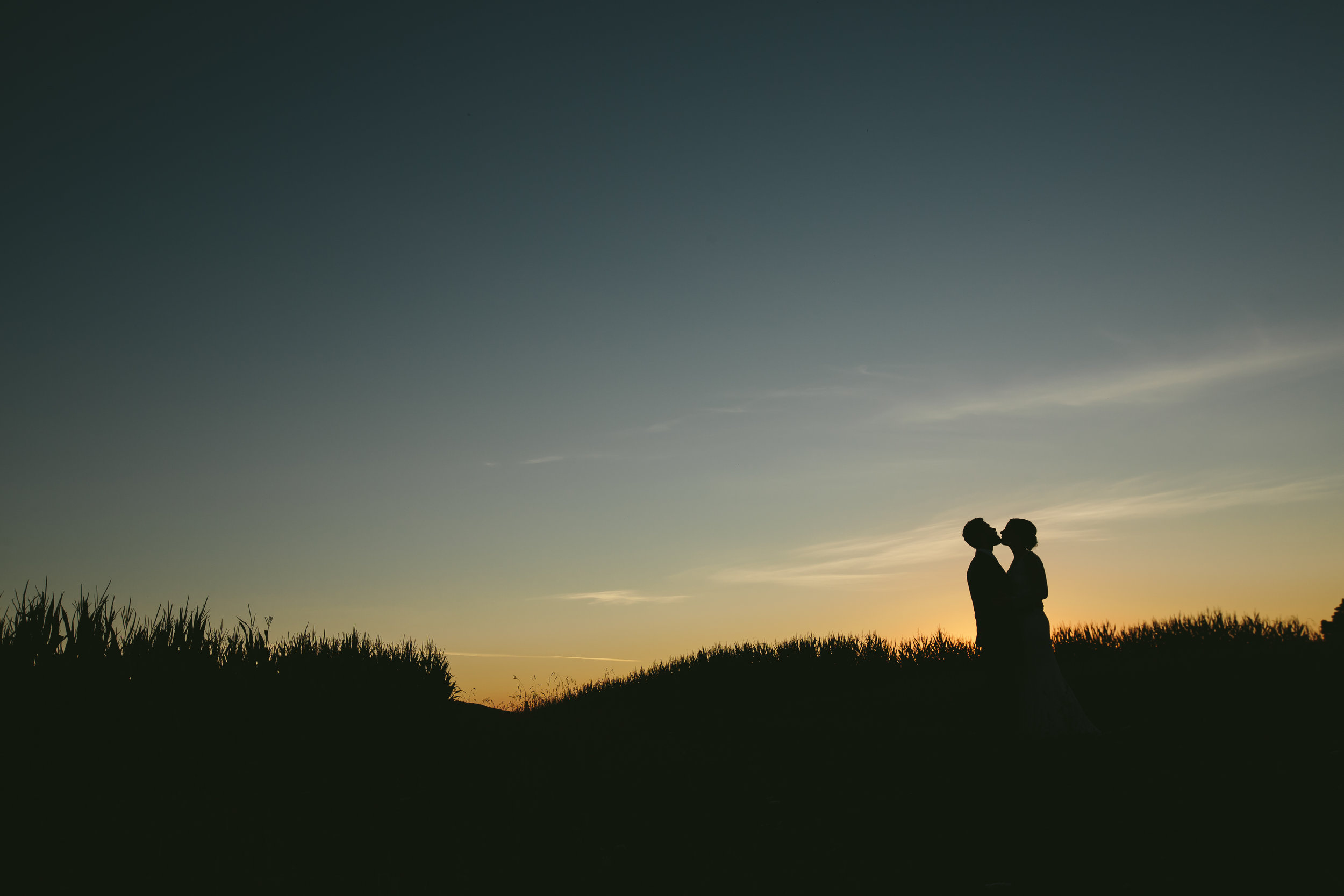 hudson-valley-farm-weddings-pioneer-farm-weddings-warwick-ny-bride-and-groom-kiss-silhouette.jpg