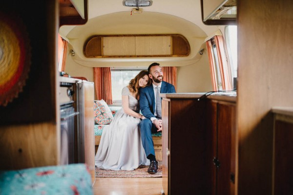 hudson-valley-farm-weddings-pioneer-farm-weddings-warwick-ny-bride-and-groom-smiling-inside-airstream.jpg