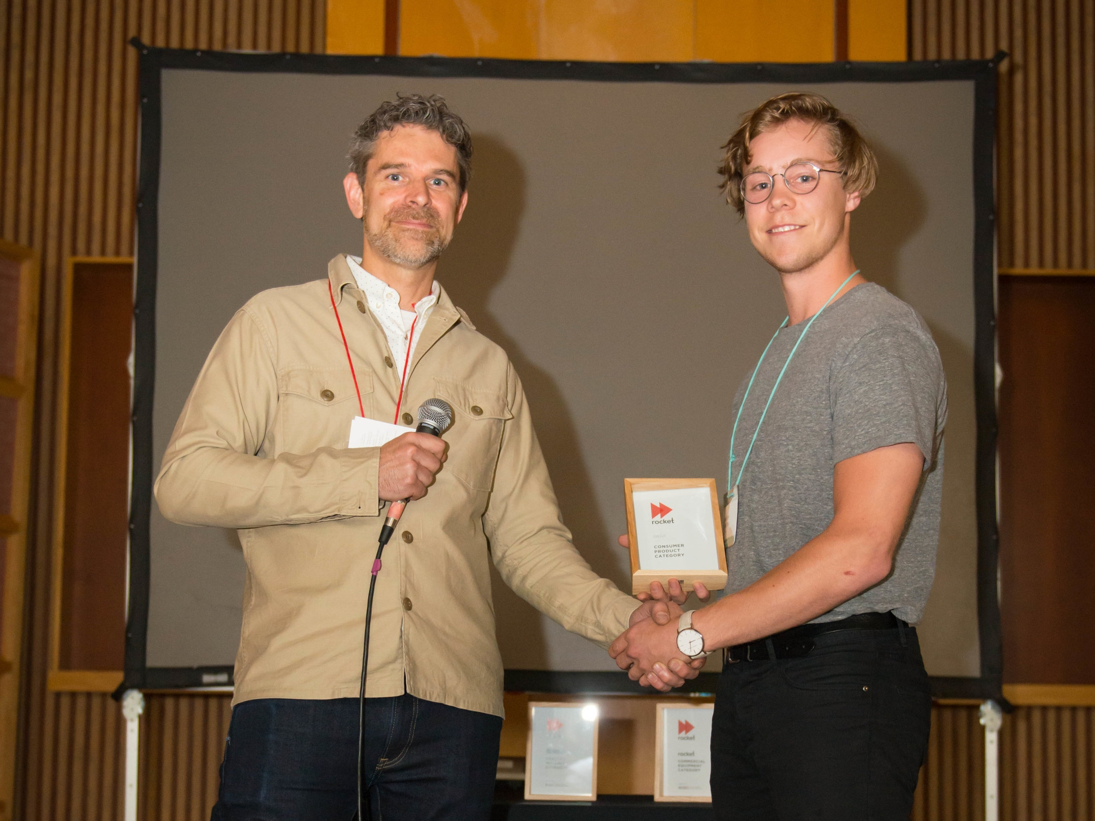 Cameron Veenstra accepting the accepting the Swave Studios Consumer Product Award from ACIDO President Jonathan Loudon.